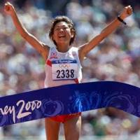 Epic: Naoko Takahashi breaks the tape at the Sydney Games to win the women's marathon in an Olympic-record time of 2 hours, 23 minutes, 14 seconds on Sept. 24, 2000. | REUTERS