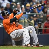 Scary situation: The Marlins' Giancarlo Stanton falls after being hit in the face with a fastball on Thursday. | REUTERS/USA TODAY SPORTS