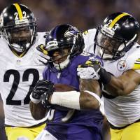 Not without a fight: Steelers defenders William Gay (left) and Mike Mitchell (right) try to tackle Ravens receiver Steve Smith Sr. during their game on Thursday night. Baltimore won 26-6. | AP