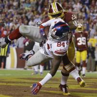 Not even close: Giants tight end Larry Donnell scores against the Redskins on Thursday. New York won 45-14. | AP