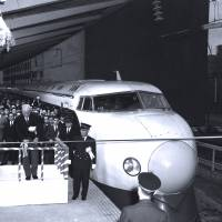 All aboard: The first departure of a bullet train on the Tokaido Shinkansen Line is marked with an official ceremony at Tokyo Station on Oct. 1, 1964.   KYODO
