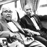 Father figures: Former JNR chief Shinji Sogo (left), the 'father of the bullet train,' sits next to JNR Chairman Reisuke Ishida during a shinkansen ride in August 1964. | KYODO