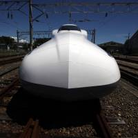 Faster than a speeding bullet: Central Japan Railway Co.'s N700A shinkansen sits in Hamamatsu City, Shizuoka Prefecture, in August 2012. | BLOOMBERG