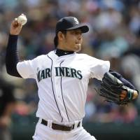 Lucky 13: Hisashi Iwakuma throws a pitch during the Mariners' win over the Nationals on Sunday in Seattle.   AP