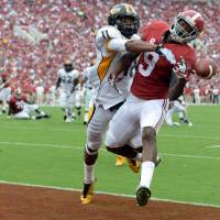 No scoring: Alabama receiver Amari Cooper (9) fails to make a touchdown catch as Southern Miss' Kalan Reed defends him on Saturday in Tuscaloosa, Alabama. | REUTERS/USA TODAY SPORTS