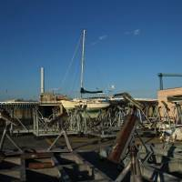 Landlubber: A small vessel is docked in boatyard adjacent to Yumenoshima's marina. | KIT NAGAMURA