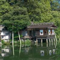 A teahouse in Kenroku-en is appealingly cantilevered over the garden's large pond. | STEPHEN MANSFIELD