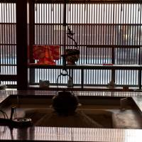 Hidden in shadow: A traditional earthen hearth at Kaikaro, a unique Higashi Chaya teahouse. | STEPHEN MANSFIELD