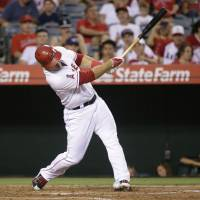 Twice as nice: Los Angeles' Mike Trout hits his second home run of the Angels' 5-2 win over the Astros on Saturday. | AP