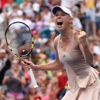 Now hear this: Caroline Wozniacki shouts after beating Maria Sharapova at the U.S. Open on Sunday in New York. Wozniacki won 6-4, 2-6, 6-2. | REUTERS/USA TODAY SPORTS