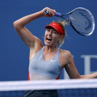 Over and out: Maria Sharapova plays a shot against Caroline Wozniacki on Sunday in New York. | REUTERS