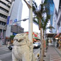 Okinawan idol: A statue of a shisa lion stands at the foot of a shopping arcade in Naha. The shisa is a traditional Ryukyuan creature and a symbol of Okinawa's distinct culture.  | © Y.Shimizu / © JNTO