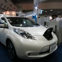 On a power trip: Nissan Motor Co.'s Leaf electric car sits on display at the Electric Vehicle and Plug-in Hybrid Vehicle Exhibition in Tokyo on Wednesday.   KAZUAKI NAGATA