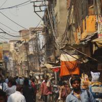 Living city: A crowded street scene in the old town of Agra, India, where shops, vehicles and pedestrians are forced to compete for space. | TATSUO KANAI