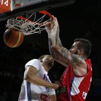 Send it in: Serbia's Stefan Markovic dunks on France's Rudy Gobert during their Basketball World Cup semifinal on Friday in Madrid. | AP