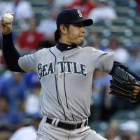 Flying under the radar: Mariners starter Hisashi Iwakuma pitches against the Rangers on Friday in Arlington, Texas. Iwakuma struck out five in a 7-5 win. | AP
