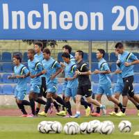 Have to start somewhere: Japan's U-21 team trains in South Korea on Friday. | KYODO