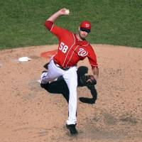 Stay at home: Washington's Doug Fister delivers a pitch during the Nationals' 4-0 win over the Marlins on Friday. | REUTERS/USA TODAY SPORTS