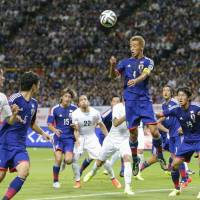 Not his style: Keisuke Honda didn't sound thrilled about wearing the captain's armband for Japan on Friday in the absence of injured midfielder Makoto Hasebe. | KYODO