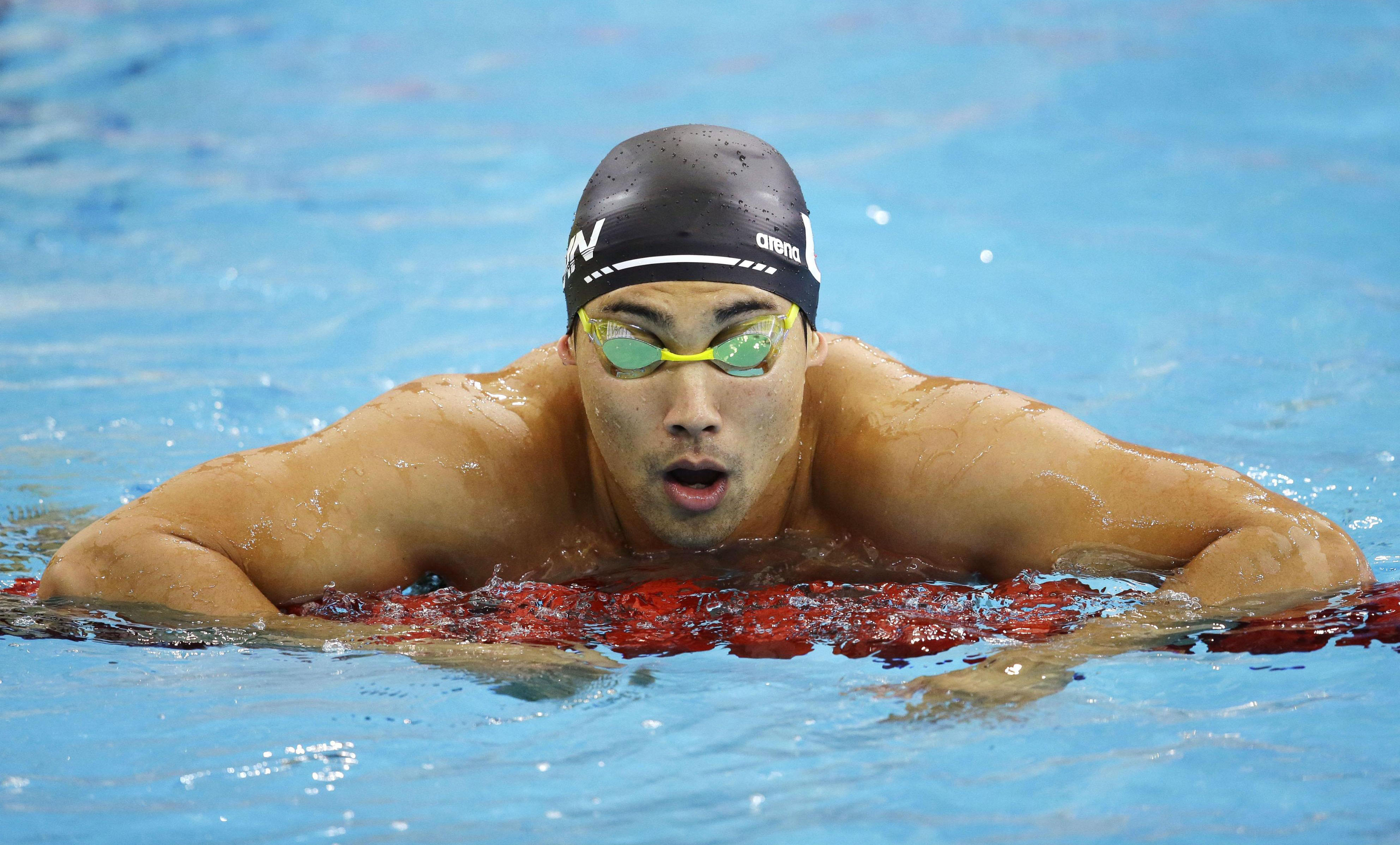 Hot water: Swimmer Naoya Tomita has been expelled from the Asian Games after admitting to stealing a photojournalist's camera. | KYODO