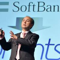 SoftBank Corp. founder and President Masayoshi Son announces the company's financial results at a press briefing in Tokyo in February. | AFP-JIJI