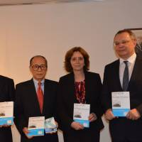 (From right) Lithuanian Ambassador Egidijus Meilunas, Israeli Ambassador Ruth Kahanoff; author Akira Kitade; and Katsutoshi Shimizu, auditor of the NPO Chiune Sugihara Visas For Life, show the book 'Visas of Life and the Epic Journey' on Sept. 10 at the Lithuanian Embassy in Tokyo. | GALINA MEILUNIENE
