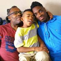 All good: Roler Miles and his sons, Tiki (center) and Dante. 'All the challenges here can't offset this one benefit of living here: The lack of stress I have because I never have to worry about my sons being shot,' says Miles.  | COURTESY OF ROLER MILES