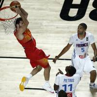 No easy feat: Spain's Rudy Fernandez scores on a reverse dunk against France in their quarterfinal game at the FIBA World Cup on Wednesday. France won 65-52. | AP