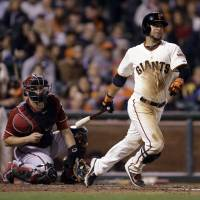 Down the line: San Francisco's Gregor Blanco doubles to right field against Arizona in the seventh inning on Wednesday night. | AP