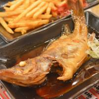 Fish and chips: The sweet ara (smelt) at Osaka seafood specialist Kaisenyatai Okuman goes great with French fries. | J.J. O'DONOGHUE