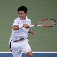 Win for the ages: Kei Nishikori plays a shot from Switzerland's Stan Wawrinka in their U.S. Open quarterfinal on Wednesday. | AP