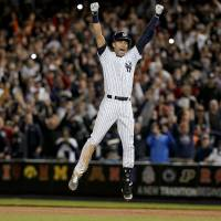 One for the road: Yankees shortstop Derek Jeter celebrates his game-winning hit against the Orioles on Thursday night in New York. Jeter singled in the winning run in the bottom of the ninth during his final game at Yankee Stadium. | AP