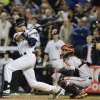 Iconic moment: Yankees shortstop Derek Jeter gets the 3,463rd hit of his illustrious career in the final at-bat of his final home game on Thursday against the Orioles, driving in the winning run on a walk-off single to right field. | AP