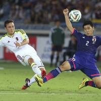 Japan squanders lead twice in draw with Venezuela