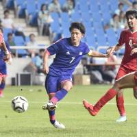 On target: Japan's Ryota Oshima scores a goal against Kuwait in their Asian Cup match on Sunday in Incheon, South Korea. Japan beat Kuwait 4-1.  | KYODO