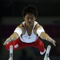 Keen concentration: Yuya Kamoto competes in the men's parallel bars final of the artistic gymnastics competition at the Namdong Gymnasium Club on Thursday in Incheon, South Korea. Kamoto earned his third gold medal at the 17th Asiad. | REUTERS