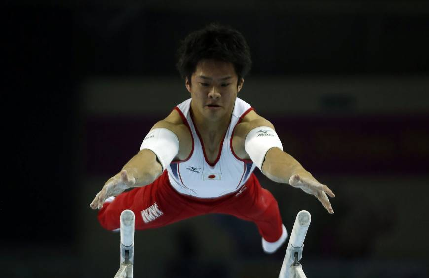 Kamoto triumphs in parallel bars