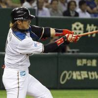 The start of something big: The Fighters' Daikan Yoh bashes a go-ahead home run in the sixth inning against the Hawks on Tuesday at Tokyo Dome. Hokkaido Nippon Ham defeated Fukuoka Softbank 10-2. | KYODO