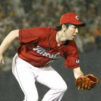 On the move: Hiroshima starting pitcher Kenta Maeda chases the ball during the Carp's 4-2 loss to the Giants on Wednesday night. | KYODO