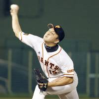 Full force: Giants starter Hirokazu Sawamura fires a pitch in Thursday's game against the Carp in Utsunomiya, Tochigi Prefecture. Sawamura held Hiroshima to five hits in seven scoreless innings, and Yomiuri earned a 1-0 victory. | KYODO