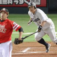 Surging ahead: Seibu's Takeya Nakamura hits a two-run go-ahead double in the eighth inning of the Lions' 6-3 win over the Hawks on Sunday. | KYODO