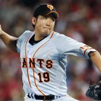 Frustrating the opposition: Giants hurler Tomoyuki Sugano fires a pitch against the Carp on Tuesday at Mazda Stadium. Sugano stuck out eight batters in 7-2/3 innings as Yomiuri downed Hiroshima 7-1. | KYODO