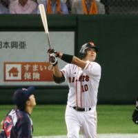 Aim to please: Giants captain Shinnosuke Abe slugs a home run in the eighth inning against the Swallows on Saturday at Tokyo Dome. Yomiuri defeated Tokyo Yakult 4-2. | KYODO
