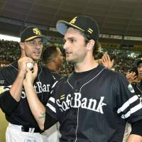 Free bird: Hawks closer Dennis Sarfate is congratulated by starter Jason Standridge and manager Koji Akiyama after recording a save against the Seibu Lions on Sunday. | KYODO