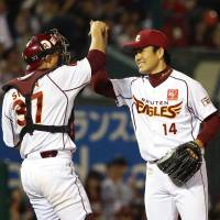 Pleasing result: Eagles catcher Motohiro Shima (left) and pitcher Takahiro Norimoto celebrate the team's victory over the Fighters on Friday. | KYODO
