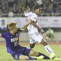 Up for the cup: Gamba Osaka striker Lins (right) scores his side's third goal in a 3-1 win over Sanfrecce Hiroshima in the fourth round of the Emperor's Cup on Wednesday.   KYODO