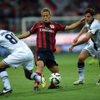 I'll take that: AC Milan's Keisuke Honda fights for the ball during a 5-4 win over Parma on Sunday. | AFP-JIJI