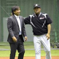 Final season: Chiba Lotte Marines catcher Tomoya Satozaki, seen with manager Tsutomu Ito, has played in just 16 games in 2014. | KYODO