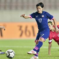 In a rout: Forward Hikaru Naomoto and her teammates cruised to a 9-0 victory over Hong Kong on Friday at the Asian Games. | KYODO