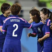 Goal parade: Japan's players celebrate the team's 10th goal against Jordan on Thursday at the Asian Games. Japan won 12-0. | KYODO